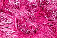 Pink and silver tinsel Christmas background stock photo