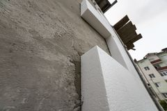 Close-up detail of plastered house wall with rigid styrofoam ins stock photos