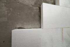 Close-up detail of plastered house wall with rigid styrofoam ins royalty free stock photo