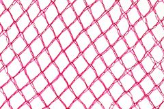 Detail of an orange mesh bag. Close up detail of a red pink orange mesh bag on a white backgroundnn stock photos