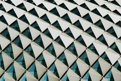 Close up detail of the roof of a building showing windows and triangular panels in a pattern. Close up image showing detail of the roof of a building showing Royalty Free Stock Photo