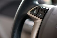Close up detail of steering wheel radio controls. Inside of a car Royalty Free Stock Photography