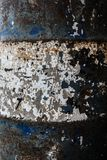 Close-up and detail of texture of a blue and white rusty fuel barrel stock photography