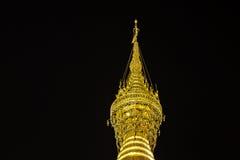 Close up detail of Top of the golden Shwedagon Paya Stock Image