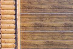 Close-up detail of wall covered with wooden siding. Part of automatic garage door . Car storage building facade part.  stock photo