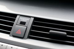 Close up detail of warning lights button and air vents inside a car. 's dashboard stock image