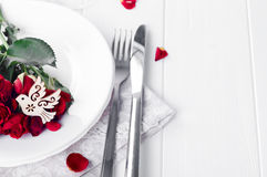 Close up of detail on wedding breakfast dining table setting with dove Royalty Free Stock Images
