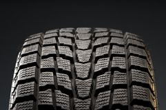 Close-up detail of winter tire. Studio close-up detail of black winter tire Royalty Free Stock Photos
