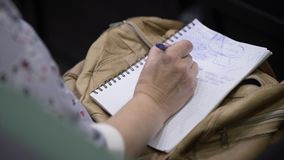 Close-up of Hands holding pens and making notes at the conference stock video