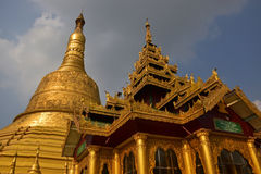 Close up detailed architecture of tallest giant stupa & house of worship in Shwemawdaw Pagoda at Bago, Myanmar Stock Photo