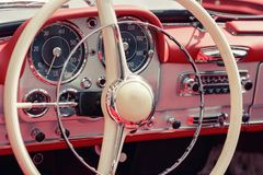 Close-up, detailed photo of the interior, dashboard steering whe. Detailed photo of the interior dashboard, steering wheel and speedometer of a classic oldtimer Stock Photos