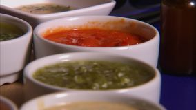 Different types of sauce. A close up detailed shot of different sauce. Pesto, marinara, cream and other. The sauce are on a white small bowls stock video