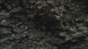 Basalt Rocks at the Black Beach in Vik. Close up detailed shot of famous basalt rocks at the Black Beach in Vik, Iceland. Volcanic geological formation. Travel stock video