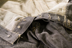 Close up detailed unzipped dark jeans Royalty Free Stock Images