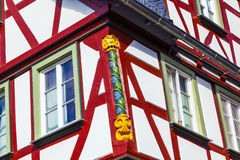 Close-up of detailing at a half-timbered house in Wetzlar, Germany. Close-up of woodcarving at a half-timbered house in Wetzlar, Germany royalty free stock photography