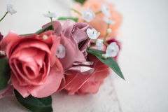 Close up details of artificial flowers on wraith. Datailed parts of handmade wraith made of pink and red rose flowers. Shallow depth of field, macro close up Royalty Free Stock Photography