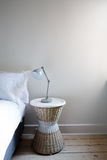 Close up details of bedside table with lamp and copy space Royalty Free Stock Photography