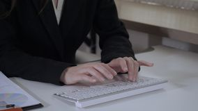 Female hands working with pc. Close up details businesswoman typing on white keyboard. unrecognizable woman entering data on computer stock video footage