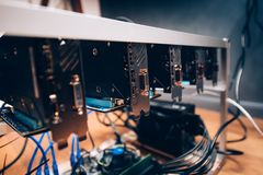 Crypto currency digital coins mining rig, graphics cards mining rig. bitcoin and blockchain technology. Close up details of crypto currency digital coins mining Royalty Free Stock Image