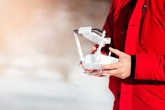 Close up details of drones remote control with man piloting the aircraft royalty free stock image