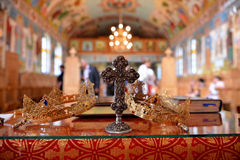 Close-up details of holy cross and wedding crowns from church Royalty Free Stock Images