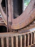 Close up details of large old rusty steel industrial cog wheels royalty free stock photography