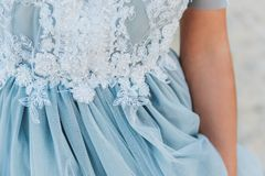 Close up of details on a light blue wedding dress stock images