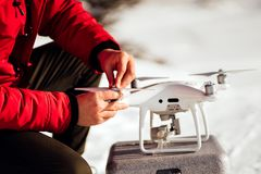 Close up details of man installing drone propellers, getting drone in air for aerial footage, videography and photography. Details of man installing drone stock image