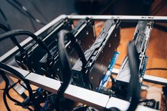 Close up details of mining rig, crypto currency modern technology. Power cables going into gpu graphics cards Royalty Free Stock Image