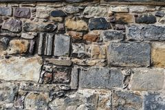 Close up details pattern of background texture of stone brick wall on ancient fortress building from medieval architecture.  royalty free stock image
