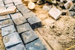 Details of roadworks. Stonework on footpath at construction site Royalty Free Stock Photos