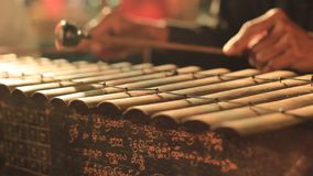 Traditional percussion instruments being played as part of a cultural performance in Northern Thailand. Close up details of traditional percussion instruments stock video footage