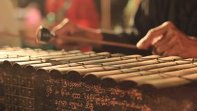 Traditional percussion instruments being played as part of a cultural performance in Northern Thailand. Close up details of traditional percussion instruments stock footage