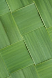 Close-up diagonal pattern of woven grass leaves Stock Images