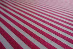 Closeup of diagonally striped fabric in pink and white. Close-up of diagonally striped fabric in pink and white Stock Images