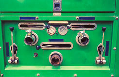 Close up of dials and controls on antique rusting fire truck Royalty Free Stock Image