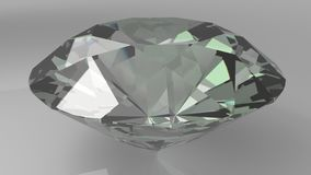 Close up of a diamond on a grey background. 3d Stock Images