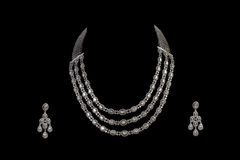 Close up of diamond necklace with diamond ear ring Royalty Free Stock Photography