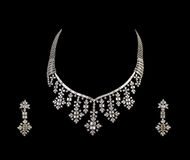 Close up of diamond necklace with diamond ear ring Royalty Free Stock Images