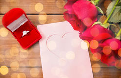 Close up of diamond ring, roses and greeting card Stock Photos