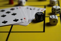 Close up of dices and cards on yellow game board stock image