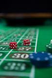 Close-up of dices and chips Stock Images