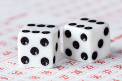 Close-up of dices on lottery ticket Stock Images