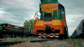 Close-up of diesel train locomotive. Slowly moving along tracks, 4k stock footage