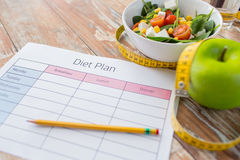 Close up of diet plan and food on table Stock Photo