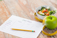 Close up of diet plan and food on table Royalty Free Stock Photography