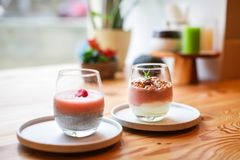Close up Dietary vegan healthy breakfast. Yogurt and granola with mint in glass On wooden table royalty free stock photography