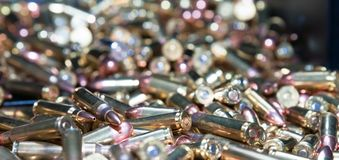 A close up of different calliber bullets. A close up of a pile of .223 and 45 caliber as well as 9mm bulletsn Royalty Free Stock Photos