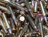 A close up of different calliber bullets. A close up of a pile of .223 and 45 caliber as well as 9mm bulletsn Stock Photo