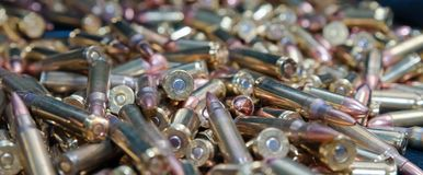 A close up of different calliber bullets. A close up of a pile of .223 and 45 caliber as well as 9mm bulletsn Stock Images
